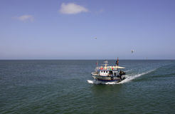 Fishing Boat Returning from Toil, Mediterranean Sea Fishermen Royalty Free Stock Photos