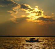Fishing Boat Returns at Dusk Royalty Free Stock Photos