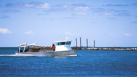 Fishing boat returns from fishing with a catch royalty free stock photos