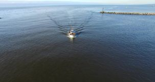 Fishing boat returns to port. Aerial footage stock video footage