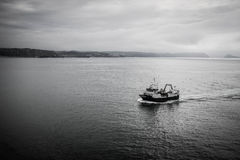 Fishing boat. Returns to port after a hard day of fishing on the high seas. Port of Aviles in Asturias, located in the north of Spain Stock Images