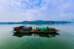 Fishing-boat on the river Royalty Free Stock Photo