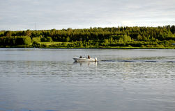 Fishing boat on  river in findland Royalty Free Stock Image