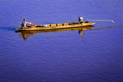 Fishing boat in the river Stock Images