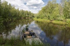 Fishing boat on the river in Siberia Stock Images