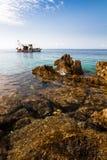 Fishing boat rocks Stock Image