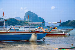 Fishing boat on rocky shore El Nido Palawan island Royalty Free Stock Photos