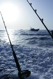 Fishing boat with rod and reels. In mediterranean sea stock photos