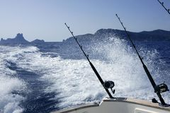 Fishing boat with rod and reels in mediterranean Royalty Free Stock Image