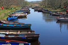 Fishing Boat Row At Killarney National Park. Fishing boats tied up at the Lakes of Killarney National Park. County Kerry, Ireland Stock Image