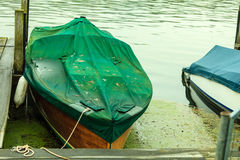 Fishing boat rowboat moored and floating at coast. Stock Photography