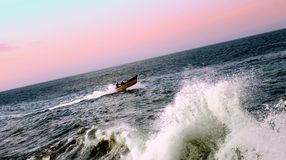 Fishing boat rushing to the harbor before the storm royalty free stock photography