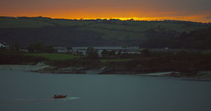 Fishing boat sailing early in the morning with the sunrise Royalty Free Stock Photos