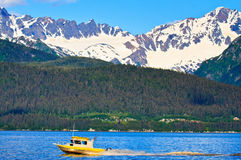 Fishing boat sailing in Resurrection bay, Alaska Stock Photo