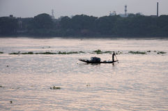 A fishing boat sailing in river Ganga Royalty Free Stock Image