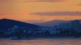 Fishing boat sailing at sunset stock video