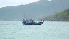 Fishing boat sails on the sea stock video