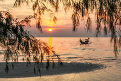 Fishing boat, sand bar, the sunset. Stock Images