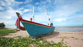Fishing boat on sand beach and blue sky background in HD, panning tracking camera shot at day light time, low angle stock footage