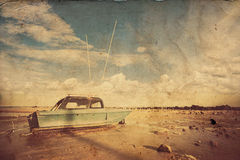 Fishing boat on sand with blue sky  in retro style Stock Images