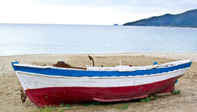 Fishing boat on sand with cloudy blue sky Stock Photography
