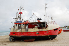 Fishing boat on the sand coast. Royalty Free Stock Image