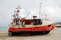 Fishing boat on the sand coast. Royalty Free Stock Image