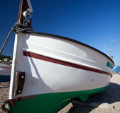 Fishing boat on the sand Stock Images