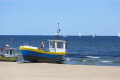 Fishing boat by the sandy beach on the Baltic Sea on a sunny day, Sopot, Poland.  royalty free stock image