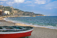 Fishing boat on a sandy beach of Italy Stock Images