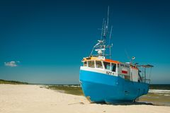 Fishing boat on sandy beach stock photography