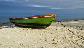 Fishing boat on sandy beach, Latvia, Europe Stock Photography