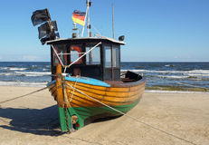 Fishing boat on sandy beach Royalty Free Stock Photos