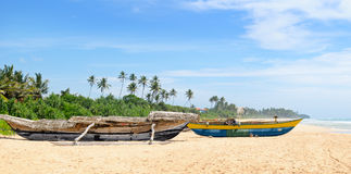 Fishing boat on the sandy shore Stock Photography