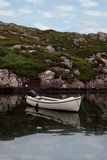 Fishing boat in a  scenic bay Royalty Free Stock Photos
