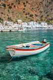 Fishing boat and the scenic village of Loutro in Crete Greece. Fishing boat and the scenic village of Loutro in Crete, Greece Stock Image