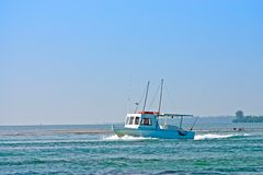 Fishing boat in sea royalty free stock photos