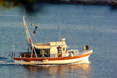 Fishing boat at sea stock photos