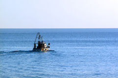 Fishing boat in sea Stock Photography