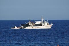Fishing boat at sea Stock Photos