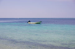 A fishing boat on the sea Stock Photography