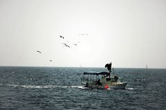 Fishing boat at sea stock images