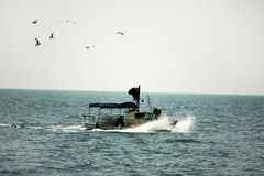 Fishing boat at sea Stock Image