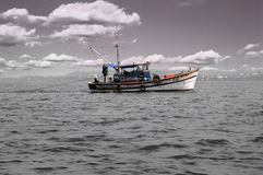 Fishing boat in the sea. Old fishing boat in the open sea stock photo