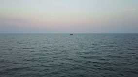 Fishing boat in the sea. aerial survey. Fishing boat in the Azov Sea at sunset. aerial survey stock footage