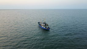 Fishing boat in the sea. Aerial survey stock footage