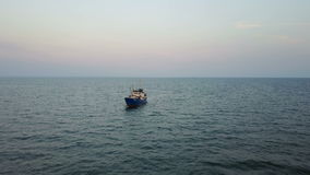 Fishing boat in the sea. aerial survey stock video