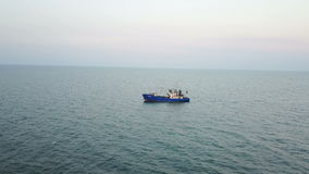 Fishing boat in the sea. aerial survey stock video footage