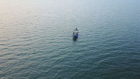 Fishing boat in the sea. aerial survey. Fishing boat in the Azov Sea at sunset. aerial survey stock video