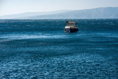 Fishing boat in the sea Stock Image